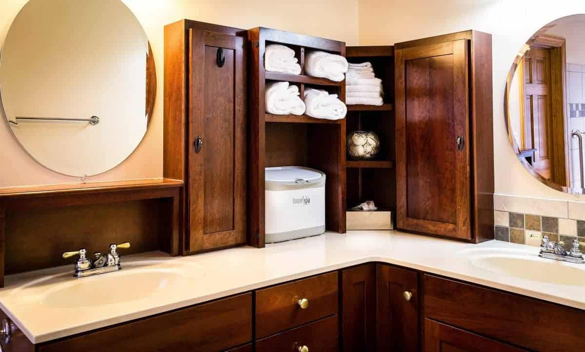 Bathroom vanity with storage tower on top of counter