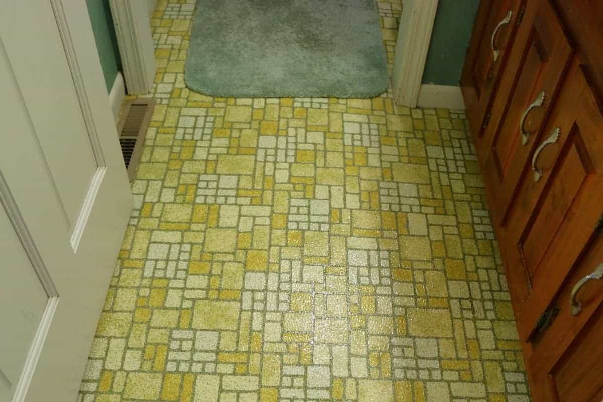 Harvest Gold sheet vinyl flooring in 1970s bathroom