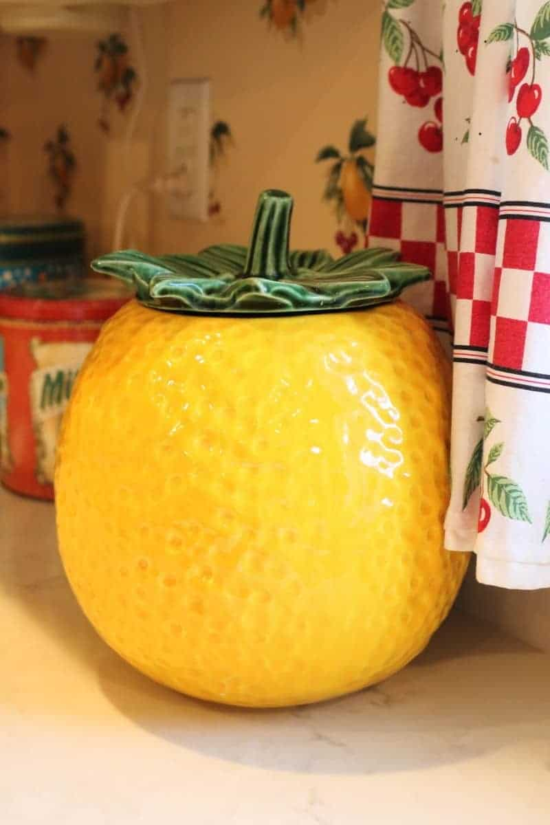 Bright yellow vintage cookie jar in the shape of a lemon