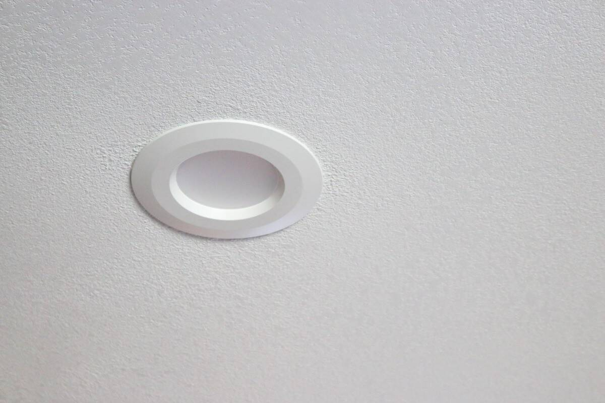 White textured ceiling with white recessed can light after kitchen remodel