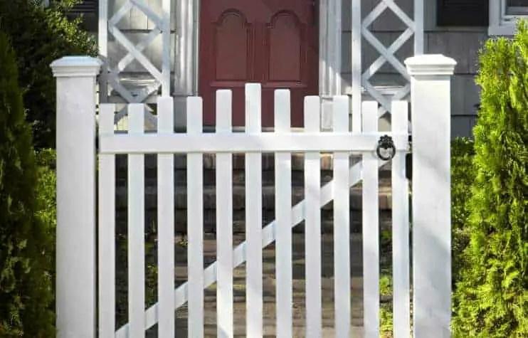 White slat wooden garden gate