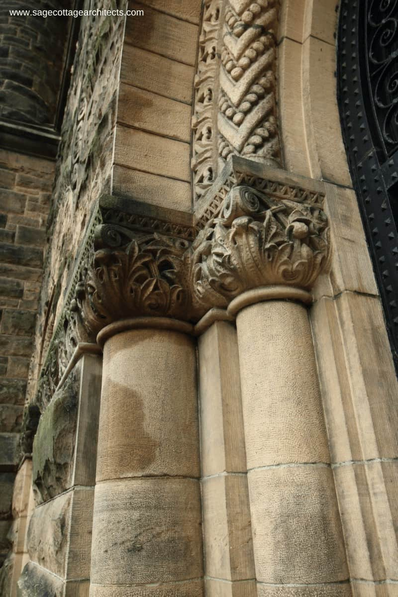 Carved limestone capitals and archway on a Richardsonian Romanesque building