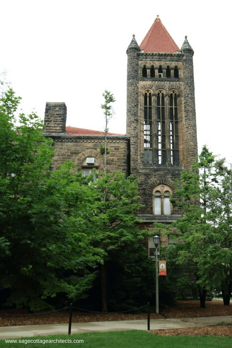 Stone bell tower with hipped roof on university campus