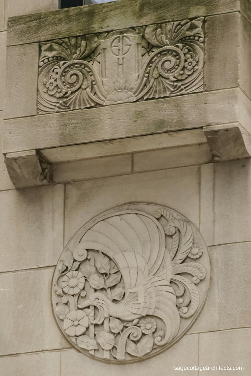 Art Deco hotel exterior in limestone, with carved decorative round panel of a bird and flowers