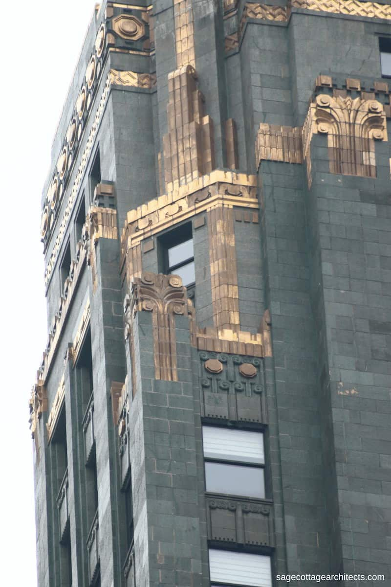 Bronze Art Deco details on dark green terra cotta walls of the Carbide and Carbon Building.
