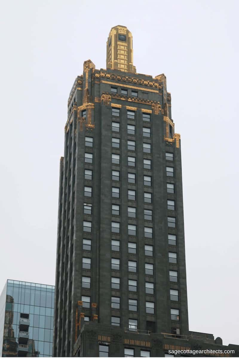 Dark grey Art Deco Carbide and Carbon tower with bronze ornamentation and gold beacon