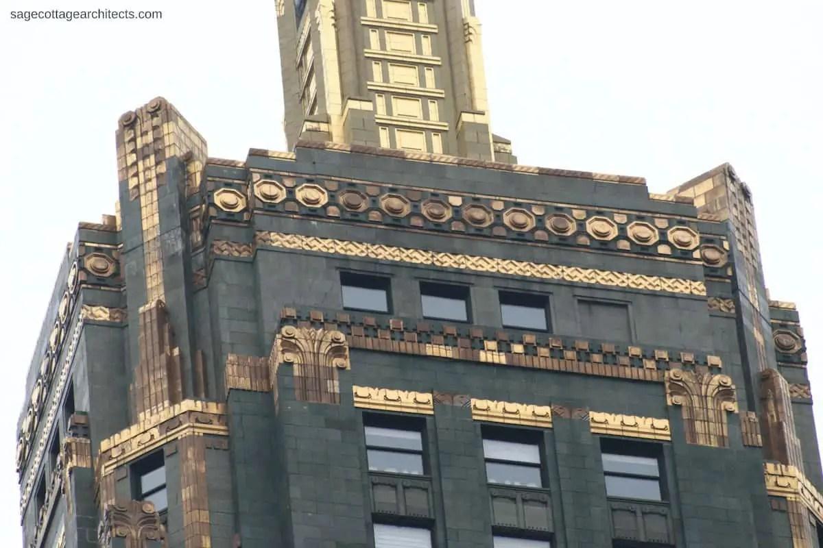 Dark green terra cotta Carbide and Carbon Building tower with bronze Art Deco ornamentation.