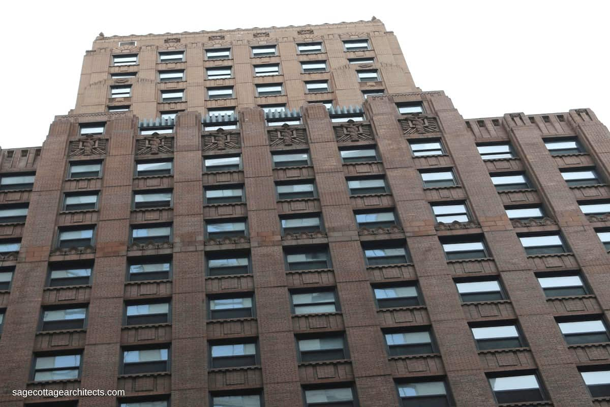 Building exterior with brown lower floors and tan upper floors.