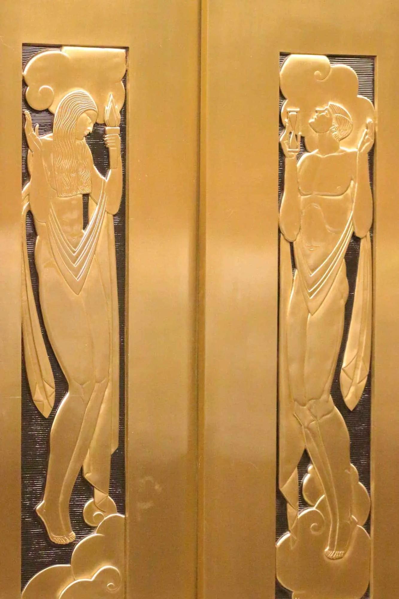 Photo of bronze Art Deco elevator door panels.