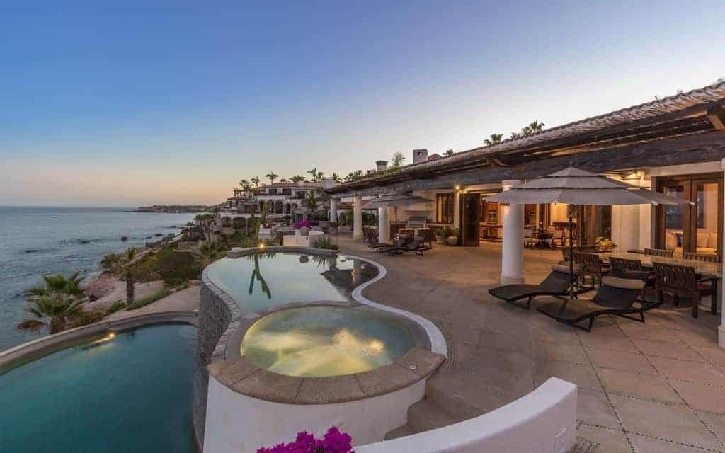Photo of a beautiful beach vacation home with patio and two pools.