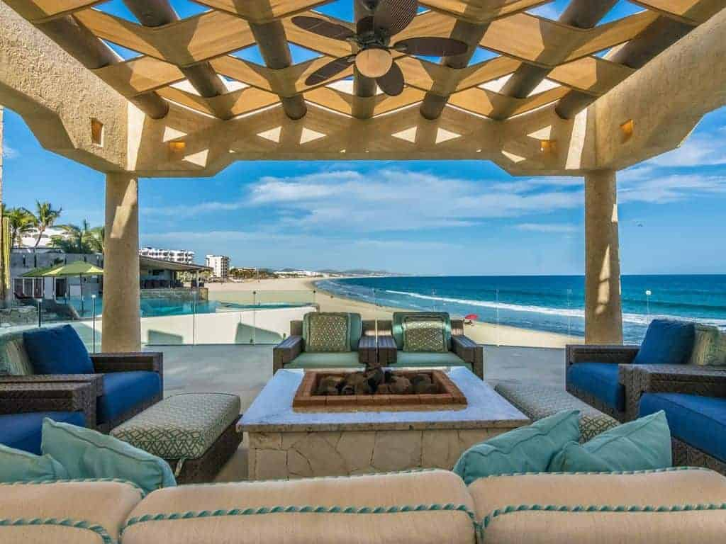 Photo of the perfect beach vacation home with a covered patio next to the ocean.