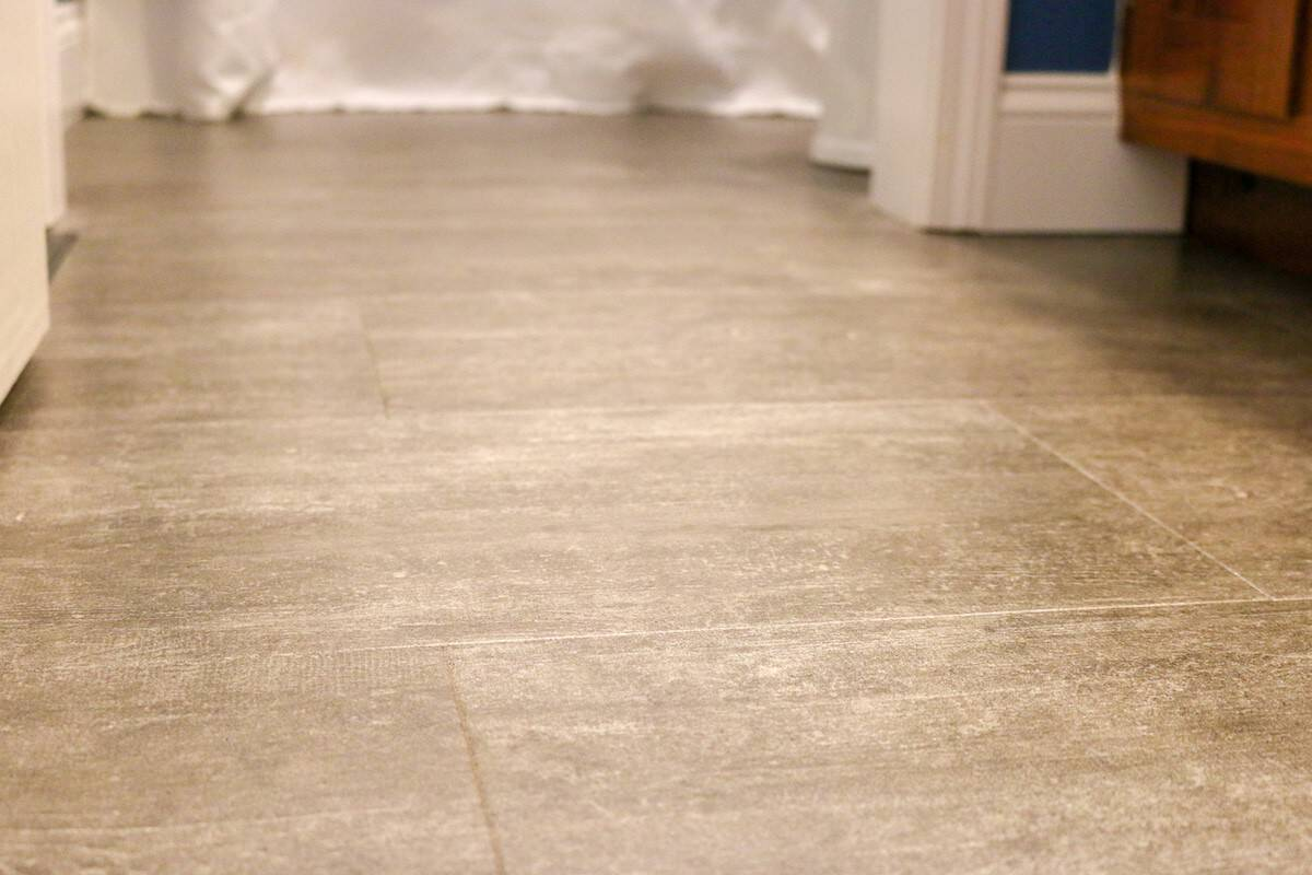 Photo of luxury vinyl tile grey floor in a bathroom