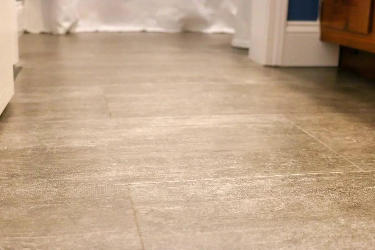 Photo of luxury vinyl tile grey floor in a bathroom