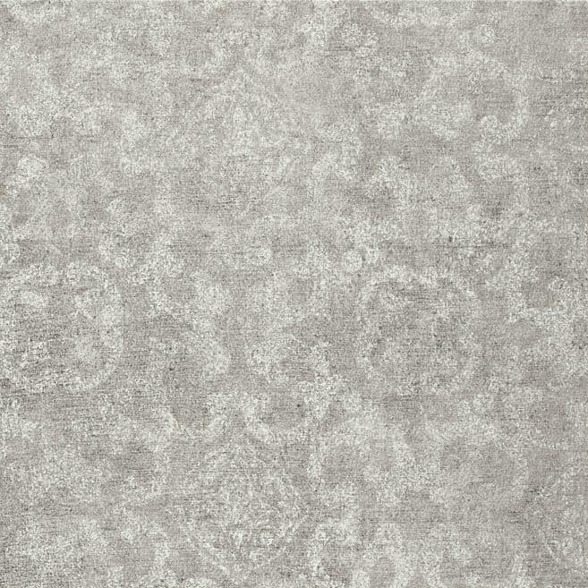 Photo of medium grey colored luxury vinyl tile floor sample with faint light colored pattern
