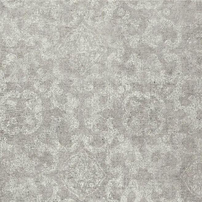 Photo of medium grey colored luxury vinyl tile floor sample with faint light colored pattern