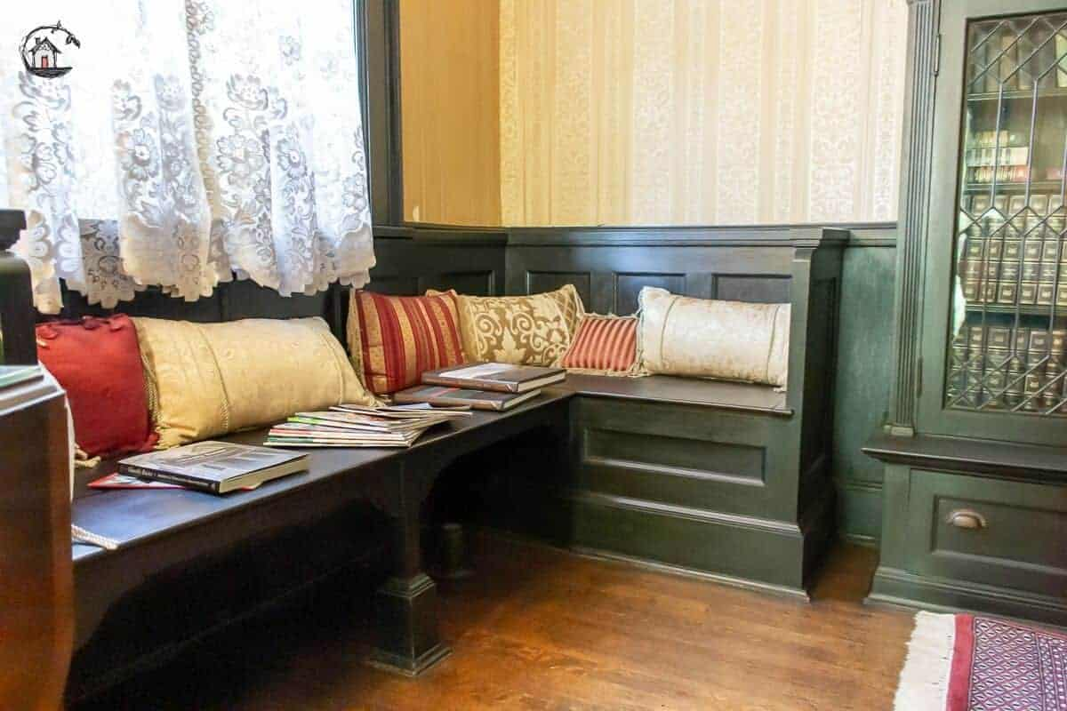 Photo of builtin bench and bookcase in the second floor library of the Vrooman Mansion.