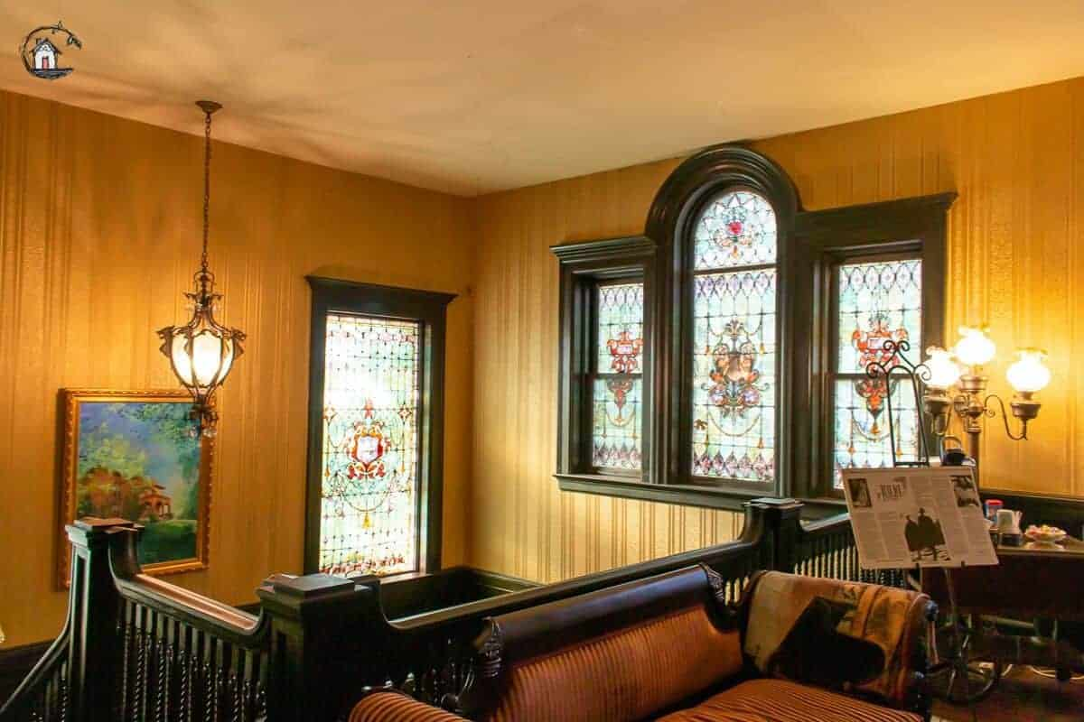 Photo of stained glass Palladian window in the stairway of the Vrooman Mansion.