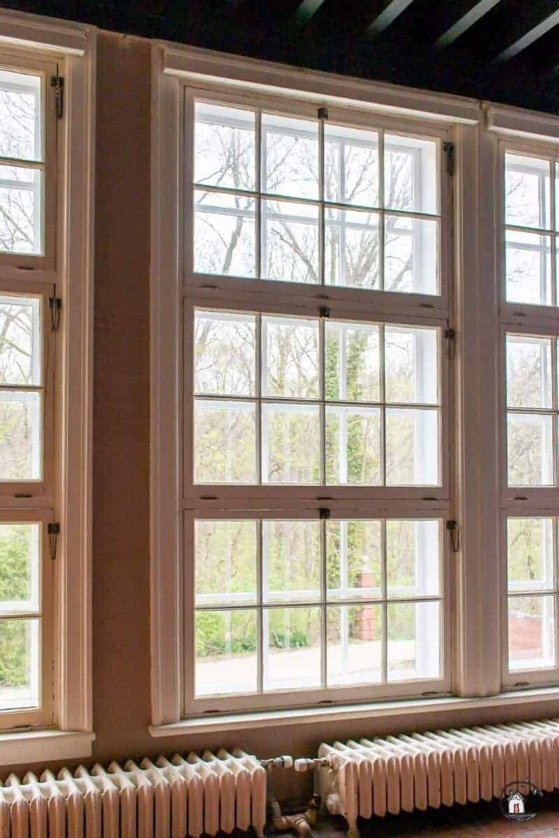 Photo of large windows in an old home. New houses should look to old houses for design inspiration.