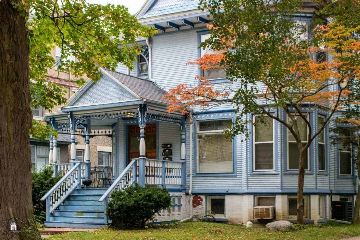 Photo of blue Victorian era home with a large porch, exemplifying one of many lessons for new houses.