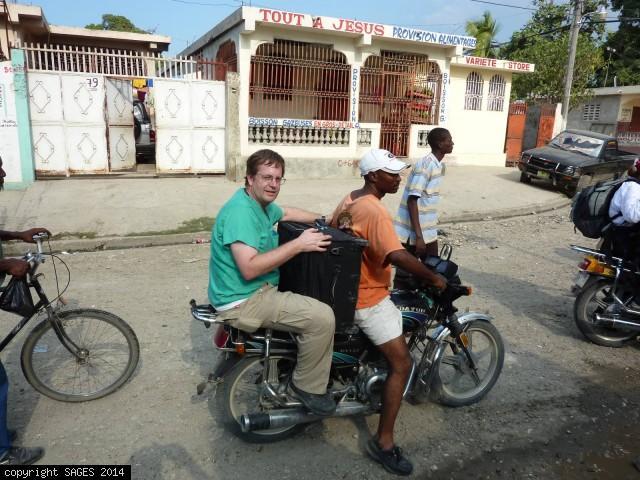 Motorcycle taxi to clinic Haiti January 2010