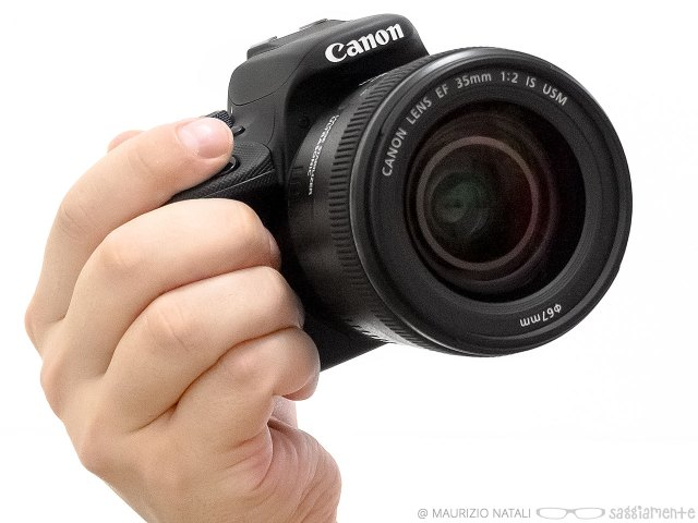 canon100d-hand-front-2