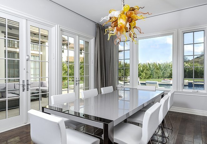 formal-dining-room-looks-fancy-floor--ceiling-windows