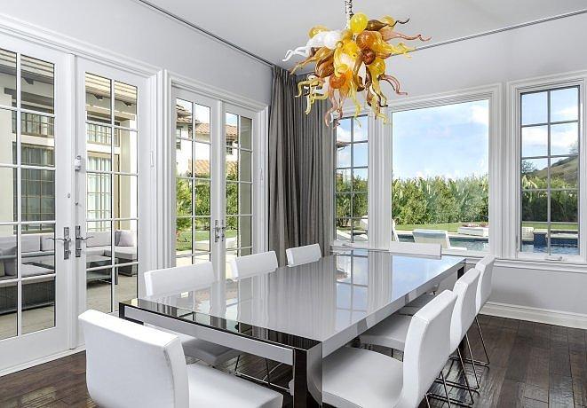 formal-dining-room-looks-fancy-floor--ceiling-windows