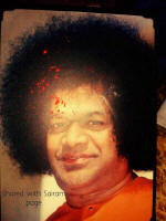 Sai Miracle photo Red Sindhur and Vibhuti appeared on Sri Sathya Sai Baba's photo during Durga Pooja in Sai devotees pooja room in New Delhi.