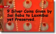 9_silver_coins_given_by_sai_baba_to_laxmibai