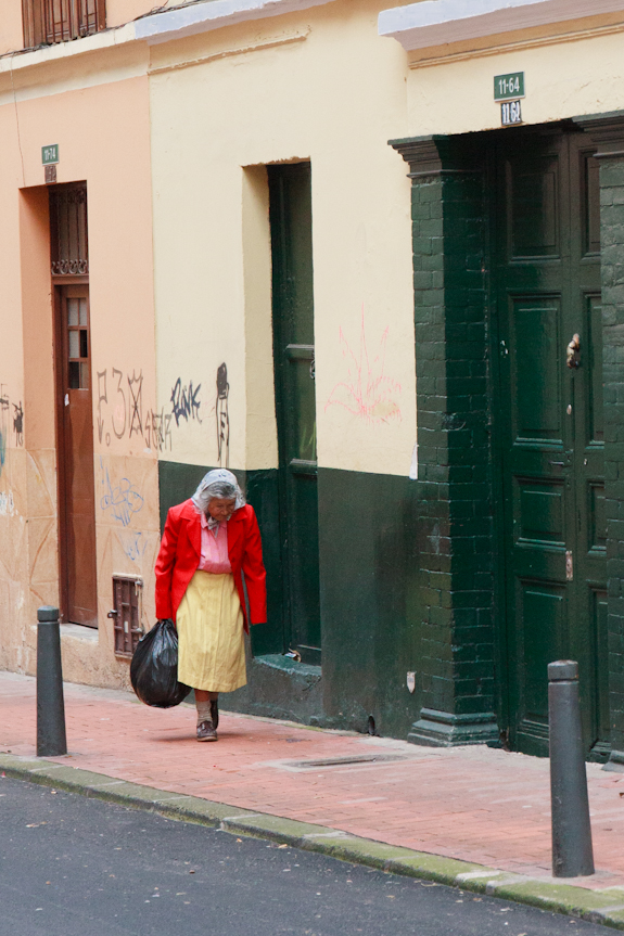 Elderly Colombian Woman Walking the Streets of La Candelaria in Bogota, Colombia