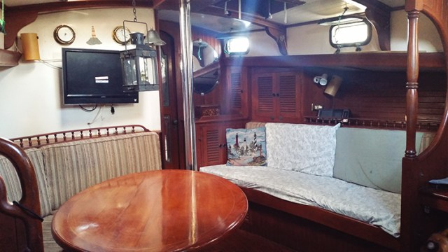 The salon of our Vagabond 42 when we bought her, before any cosmetic upgrades.