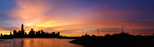 An insane sunrise view of the skyline as seen from the upper deck of Liberty Landing Ferry.