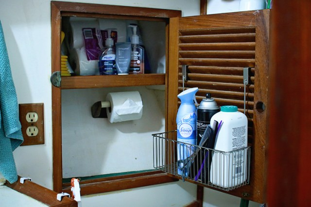 Over the cabinet door racks work well to add usable storage to louvered cabinet doors