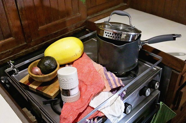 A 2-in-1 salt and pepper shaker and pan with built in colander make cooking on a sailboat much easier.