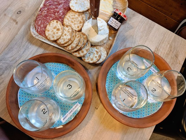 Wine flights and charcuterie plate at Bridge Lane Winery during our Long Island Wine tour by boat