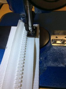 Sew the zipper so that the teeth are on the pressed open seam