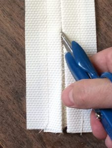 Cut open the seam exposing the zipper teeth