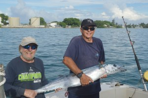 Jeff Hartjoy of Sailors Run and Chuck Gauthier pose with the wahoo they caught on Wasabi. Photo: Karen Earnshaw