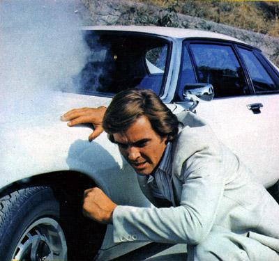 Ian Ogilvy Hiding Behind his white Jaguar XJS
