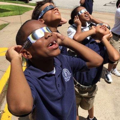 children viewing eclipse