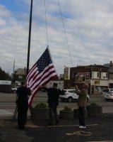 Raising the new flag