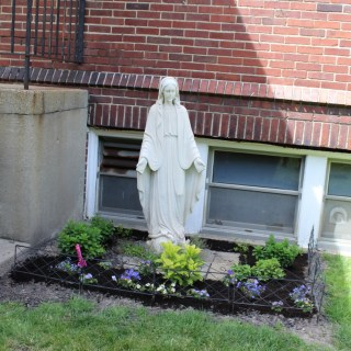 Our very first Mary, now in back of the Convent/Parish Center