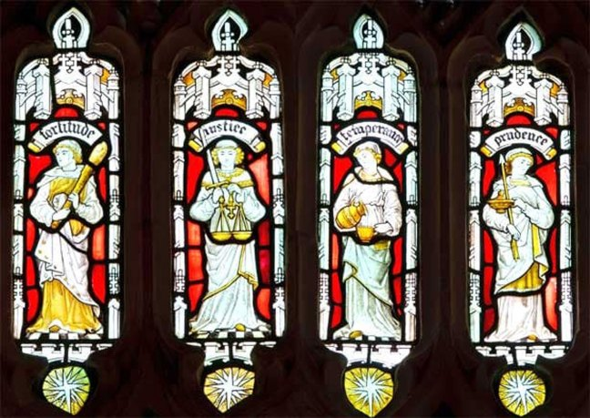 The Four Cardinal Virtues depicted in stained glass.