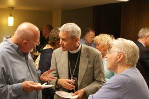Bishop James Gonia with Saint Paul members