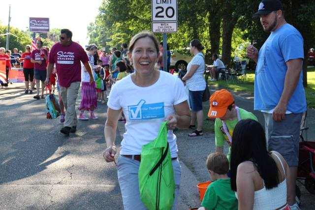 Lisa Thompson engaging with parade goers.