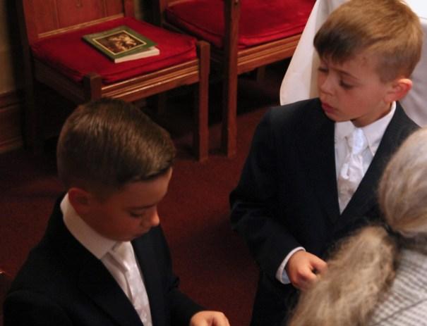 First Communion Boys wait in sacristy