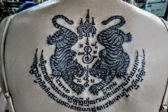 Sak Yant Suea Koo tattooed on upper back