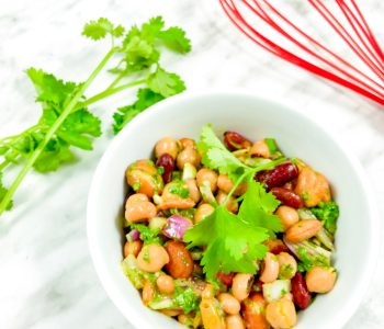 THIS BEAN SALAD IS DELICIOUS! Perfect year round, this fibre-richsaladis a great way of incorporatinglegumesinto your diet.This can be served as a side dish, perfect for potlucks or to make it a main for lunch serve it over spiralized cucumbers. | Legume Salad | Easy Salad | Picnic Salad | www.salads4lunch.com #saladrecipe #beansalad #legumesalad #hearthealthy