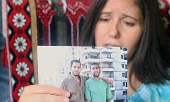 Laila Yaghi holds a picture of her son, Ziyad Yaghi
