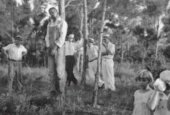 An actual KKK lynching of a lone outnumbered black man, much like Bobby Tillman.